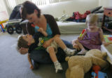 DM0699  Amber Shearer, 24, hangs out with her two-year-old twins Atticus and Damia Tyler at their...