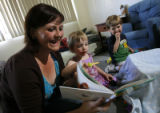 DM0739  Amber Shearer, 24, hangs out with her two-year-old twins Atticus and Damia Tyler at their...