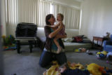 DM0777  Amber Shearer, 24, hangs out with her two-year-old twins Atticus and Damia Tyler at their...