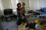 DM0779  Amber Shearer, 24, hangs out with her two-year-old twins Atticus and Damia Tyler at their...