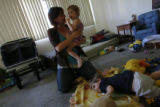 DM0785  Amber Shearer, 24, hangs out with her two-year-old twins Atticus and Damia Tyler at their...