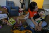 DM0848  Amber Shearer, 24, hangs out with her two-year-old twins Atticus and Damia Tyler at their...