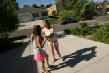 MJM187  Killian Adams, left, 12, holds hands with neighbor, Rebekah Rudd (cq), 12, as she plays...