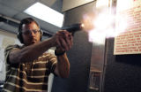 Brad Mitchell, of Denver, practices at the firing range at the Shootist in Englewood, Colo., on...