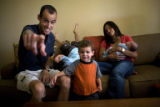 Two-time Olympian Alan Culpepper (cq) points toward the camera to show his two-year-old son Levi...