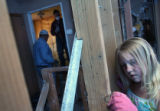 MJM468  Kristen Pallasch (cq), 9, tries to get a nail out of a beam in the upstairs of Maggie and...