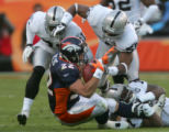 (269) Peyton Hillis is tackled by the Raiders defense in the second quarter of the Denver Broncos...
