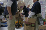 (at center) LIz Tibwell (cq), and other employees at this Wallmart in Stapleton get ready to stock...