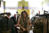 (107) Tina Call (cq), of Greeley,laughs while trying on a vest at Wild at Heart, a women's...