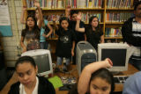 Kids wait to ask questions as they participate in a discussion with Patricia Slaughter (cq),...