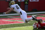 (0422) Nate Swift scores a touychdown in the first quarter of Colorado against Nebraska at...