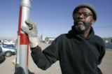 Dwight Ivory picks up trash as he works a day labor job Friday November 28. 2008. He was grateful...