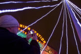 (256) People indulge their holiday spirit as they enjoy the Christmas lights of the Larimer...