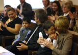 MJM437  Joshua Scott, 6, is hugged by adoptive mother, Judy Scott (cq) during the formal adoption...