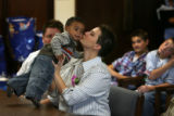 MJM502  Cynthia Martinez (cq) kisses her adopted son, Kyler Stiebig, 1, as Cynthia's partner, Keri...