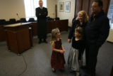 MJM648  Judge Brett Woods (cq), top center, watches as Alice Mendoza, 5, left, and her sister,...