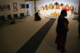 MJM111  Jigisha Yagnik (cq) stands in the worship area at a Hindu Temple in a converted home in...