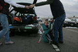 Holding his son Zane, 1, (cq) Blaine McCleskey (cq) hands his car keys to his wife Adrienne...