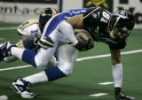 Rashad Floyd, of the Colorado Crush, tackles Chris Jackson, of the Georgia Force, short of the...