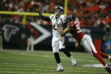 BroncosAtFalcons55712  Jay Cutler looks scrambles under pressure from Falcons Jamaal Anderson,...
