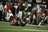 BroncosAtFalcons55712  Wide receiver, Brandon Stokley, pulls in a pass and is stopped by Falcons'...