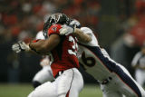 BroncosAtFalcons55712  Falcons number 33, Michael Turner is tackled by Broncos number 46, Spencer...