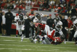 BroncosAtFalcons55712  Atlanta's Jerious Norwood is brought down by Broncos defenders at the...