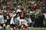 BroncosAtFalcons55712  Falcons quarterback, Matt Ryan, gets the ball away before being hit by a...