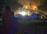 A fire burns through the top floors of an apartment building at 5620 Arapahoe Avenue in Boulder on...