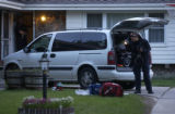 Aurora police and investigators search the residence of 1585 S. Ironton Sunday evening June 12,...