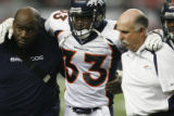 DM1532  Denver Broncos safety Marquand Manuel #33 is helped off the field in the fourth quarter at...