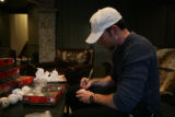 Philadelphia Phillies relief pitcher Brad Lidge (cq) signs 1 of 400 baseballs at his home in...