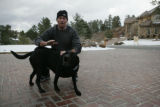 Philadelphia Phillies relief pitcher Brad Lidge (cq) pets his dog Meg (cq) at his home in Colorado...