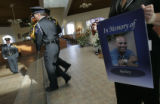 (286) Kim Stewart holds a picture of Rodney Morales as Aurora Police Kevin Palacio, and Gretchen...