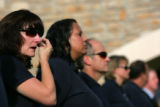 (592)  Aurora Code Enforcement Officer Ricki Fletcher wipes away a tear as she waits in line for...