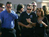 (623) Code Enforcement Officer Barry Dombrowski walks with Rodney's mother Sandra Rodriguez before...