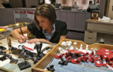 Lisa O'Meara (cq) works on pricing jeweler for a going out of business sale, Tuesday morning,...