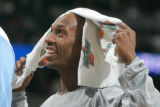 0353 Denver Nuggets guard Chauncey Billups #7 smiles as he spends most of the fourth quarter  as...