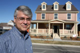 "Gene Myers (cq), head of New Town Builders, stands in front of ""The Challenge House""  ..."