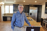 "Gene Myers (cq), head of New Town Builders, stands inside the kitchen  of ""The Challenge..."