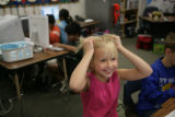 Mattie Martin, 7, (cq) a student at Acres Green Elementary school, 13524 Acres Green Drive in...