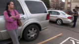 Karina Patton (cq) stands next to her vehicle  while Aurora Police Sgt. Dan Mark (cq) issues a...