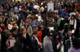 (PG1092) Unemployed workers talk with companies at a job fair in Longmont, Colo., on Wednesday,...