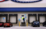 (PG865) An early arrival heads into American Furniture Warehouse for a job fair in Longmont,...