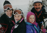 L-R- Ann, Maggie, Emily, and Kirk Hanna  are pictured together in their last family ski photo...