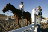 FOR SLIDESHOW- Ann Hanna works with  student, Maya Kobacker with  riding and jumping lessons  at...