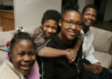 The Johnson family sit in their living room in their Aurora home Monday November 24, 2008. L-R ...