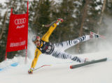 DM0389  BirdsOfPrey56022 Germany's Andreas Strodl flies sideways with both skis off the ground and...