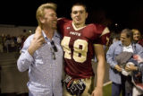 Faith Christian's Robert Bray, right, with his father, Robbie Bray, following Faith Christian's...