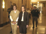 Lisl Auman (handcuffed) leaves Denver District Court on Tuesday May 31,2005. Auman was granted a...